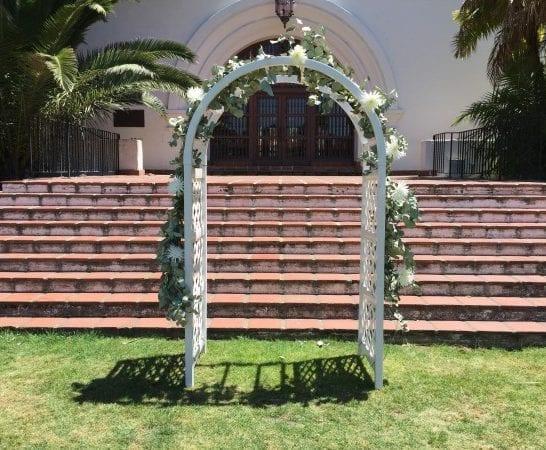 white resin wedding arch